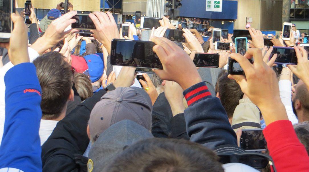 A crowd using smartphones