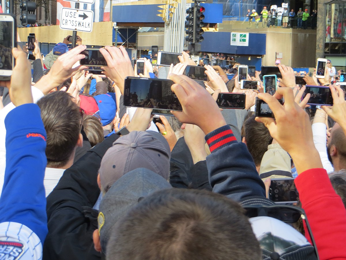 A crowd using smartphones